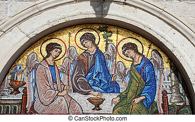 Mosaic over the entrance of the Holy Trinity Orthodox Church...