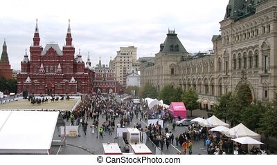 MOSCOW - AUG 31: People walk near to the Historical museum and GUM, festival SPASSKAYA BASHNYA on Red Square on Aug 31, 2011 in Moscow, Russia
