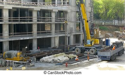 Crane operates at construction site at Losiniy Ostrov estate...