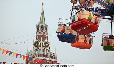 Moscow. Christmas. Entertaining attractions at the Kremlin. People in the booths are attracted by balloons. New Year theme.