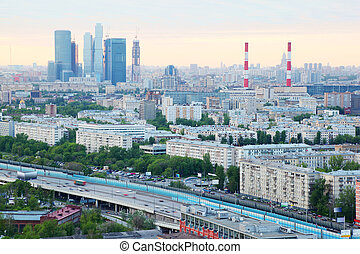 Moscow City complex, pipes and panorama of Moscow at dull day