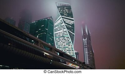 Moscow city modern buildings at night with haze