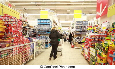 People choose products in new shopping and entertainment center TROYKA