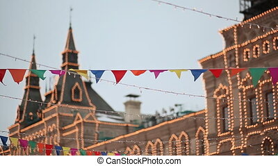 Moscow. Illumination of an architectural building for Christmas. Hanging flags on the streets of the city. Evening. Moscow Kremlin. New Year theme.