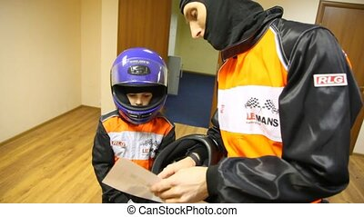 Father gives instructions to son before go-cart racing -...