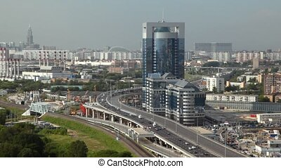 Cars on road near Northern Tower of Moscow International Business Center