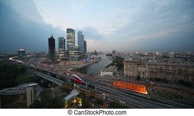 Moscow International Business Center and flag of Russia on foreground