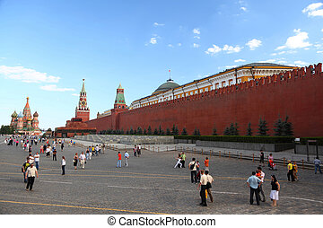 MOSCOW-JUNE 21: Tourists on Red Sguare near Kremlin wall,...