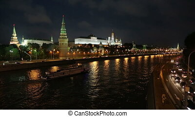 Moscow Kremlin and ship on river at night - Russia
