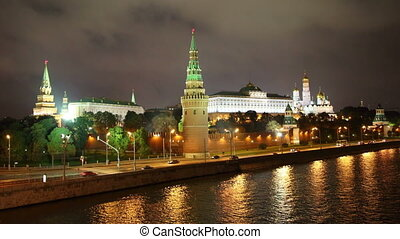 Moscow Kremlin and ships on river at night - timelapse