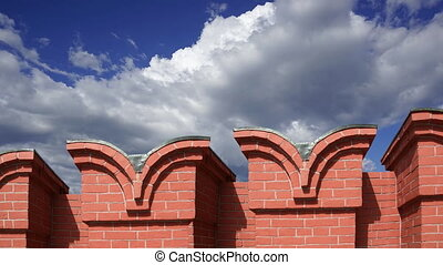 Moscow Kremlin, Russia. Fragment of the Kremlin wall against the moving clouds. UNESCO World Heritage Site