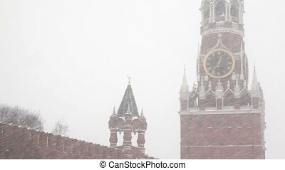 Moscow Kremlin's Spasskaya Tower under windy showfall