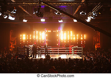 MOSCOW - MARCH 12: People stand at boxing ring before fight at Fight Nights Battle of Moscow-3 in Crocus City, on March 12, 2011 in Moscow, Russia.