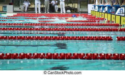MOSCOW - MAY 10: Sportsmen in relay, some finish breaststroke, others start on open championship of russia's swimming in sports complex Olympiysky on May 10, 2010 in Moscow, Russia.