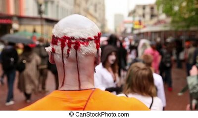 MOSCOW - MAY 14: Zombie Parade by stree with bloody head after trepanation of skull during Zombie Parade on May 13, 2011 in Moscow, Russia