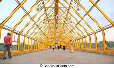 People walk on the Andreevsky bridge