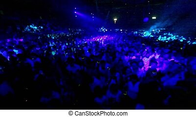 MOSCOW - MAY 6:Crowd dance at rave party, view from above in motion, pink blue illumination on May 6, 2011 in Moscow, Russia.