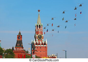 MOSCOW - MAY 9: Helicopters with flags fly over Red Square, ...