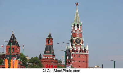 Nine fighter planes aligned diamond fly over Red Square