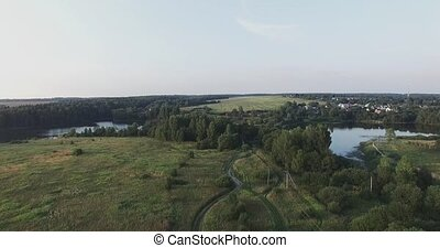 Moscow oblast, Russia. The camera flies over the green meadows, to forests and blue lakes.
