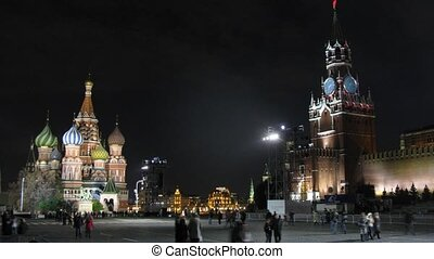 People walk on Red Square in night on festival CIRCLE OF LIGHT