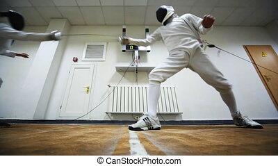 Boy does girl prick in training sword fencing at club Dynamo...
