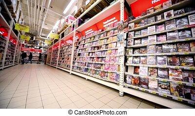 Showcase with dvd discs with varius films in hypermarket Auchan