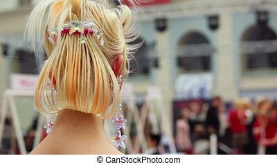 Back of woman with fanciful hairdo at XVII International...