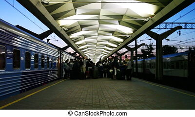 Moscow railway station platform with passengers and train at...