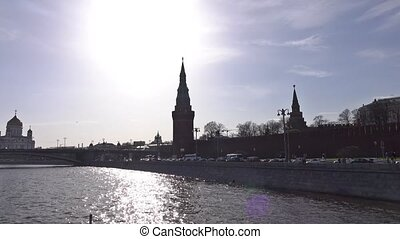 Moscow river and Kremlin silhouette on a sunny day as seen from the boat. 4K pan shot
