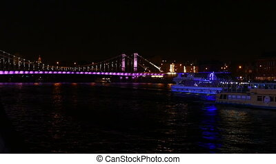 Moscow River in the center of the city at night in the fall with ships
