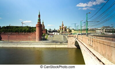 MOSCOW, RUSSIA - 26 May 2014: City traffic along Kremlin, Red Square in Moscow, Russia.