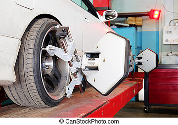 Moscow, Russia - August, 26, 2016: Wheel alignment equipment on a car wheel in a repair station in Moscow, Russia