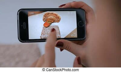 Woman using smartphone with augmented reality app and...