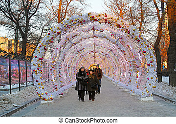 "People and tourists walk in the Christmas light tunnel on Tverskoy Boulevard decorated as part of festival ""Journey to Christmas"""