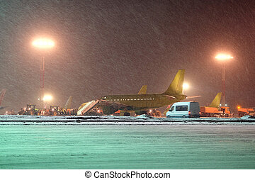 airplane parking at the airport in winter