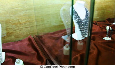 Showcase jewelry on neck in one store in salon Estet -...