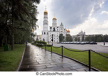 Moscow, Russia-July 20, 2010. Many tourists visit the Kremlin and Belfry of Ivan the Great each year where they mix with official cars and policeman
