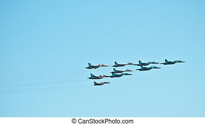 """MOSCOW, RUSSIA - MAY 9, 2013: fighters at air-force show. """"Russian knights"""" team in Tushino airdrome"""