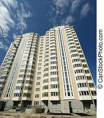 Moscow, Russia, the new multi-storey residential building on a background of blue sky