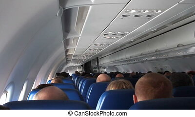 airplane with passengers on seats. - Moscow, Russian...