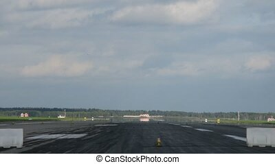 Planes by turns fly up and land on take-off field at...