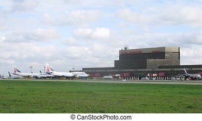 Planes TRANSAERO stand on field near building of airport -...