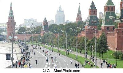 Participants run along quay on XXX MOSCOW INTERNATIONAL PEACE MARATHON