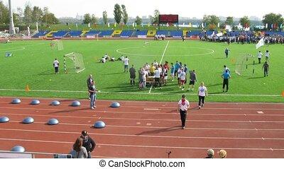 Participants of Big races walk at stadium Yantar in Strogino