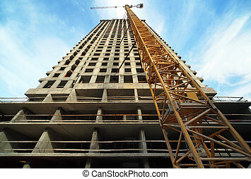 MOSCOW - SEPTEMBER 27: Tall building under construction with...