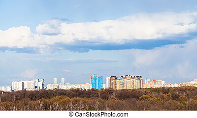 Moscow skyline with urban park in early spring