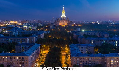 Moscow State University night to day transition timelapse before sunrise aerial view from rooftop. Popular landmark in Moscow the capital of Russia. Morning mist