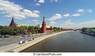 Moscow view. Kremlin, Golden dome churches, river. Car traffic near.