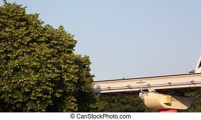 MOSCOW,?RUSSIA - JUNE 22: Monorail train goes against the trees?June 22, 2009 in Moscow, Russia. On November, 20th 2004 the first public monorail road in Moscow is opened.